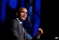 FILE - In this Dec. 12, 2018, photo, former President Barack Obama accepts the Robert F. Kennedy Human Rights Ripple of Hope Award at a ceremony in New York.