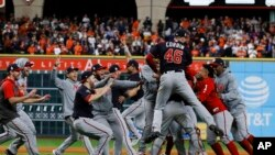 The Washington Nationals celebrate after Game 7 of the baseball World Series against the Houston Astros Wednesday, Oct. 30, 2019, in Houston. The Nationals won 6-2 to win the series. (AP Photo/Matt Slocum)