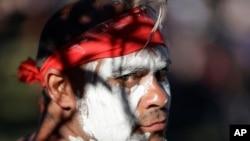 Russell Dawson of the Koomurri Aboriginal Dancers participates in a smoking ceremony during Australia Day ceremonies in Sydney, Jan. 26, 2021.
