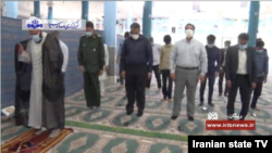 Iranian worshippers wear face masks and adopt the unusual practice of standing apart at a reopened mosque in Rigan County, Kerman province, as seen in a May 5, 2020 report on Iranian state TV.
