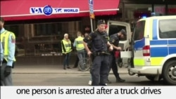 VOA60 World PM - Truck Crashes Into Swedish Shopping Center Killing At Least Three People