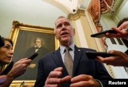 FILE - U.S. Senator Thom Tillis (R-NC) talks to reporters at the U.S. Capitol in Washington, Jan. 30, 2020.