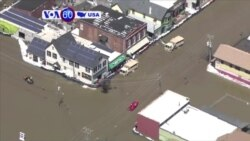 VOA60 America - People in flooded areas of the Midwest prepare for another round of heavy rain
