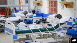 FILE - Coronavirus patients receive oxygen in the intensive care unit of a hospital in Machakos, Kenya, Aug. 20, 2021.