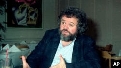 FILE - This 1990 file photo shows director of photography Allen Daviau speaking during an interview in Los Angeles. Daviau, who shot three of Steven Spielberg's films, died April 14, 2020.