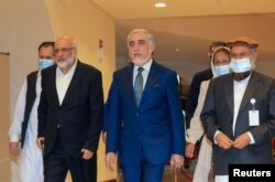 Abdullah Abdullah, the Chairman of Afghanistan's High Council for National Reconciliation, arrives for Afghan peace talks in Doha, Qatar, Aug. 12, 2021.