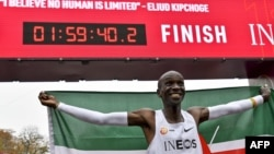 Kenya's Eliud Kipchoge celebrates after breaking the two-hour barrier for the marathon, Oct. 12, 2019, in Vienna.