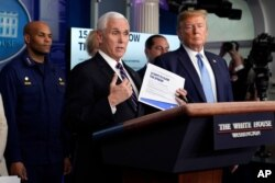 Vice President Mike Pence speaks as President Donald Trump listens during a press briefing with the coronavirus task force, at the White House, March 16, 2020, in Washington.