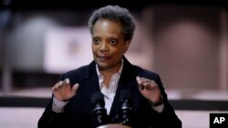 FILE - Chicago Mayor Lori Lightfoot speaks during a news conference in Hall A at the COVID-19 alternate site at McCormick Place in Chicago, April 10, 2020.