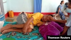 A coronavirus disease (COVID-19) patient is comforted by a family member at the hospital in Cikha, Myanmar, May 28, 2021.