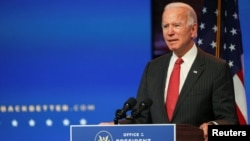 U.S. President-elect Joe Biden speaks to reporters following an online meeting with members of the National Governors Association (NGA) executive committee in Wilmington, Delaware.