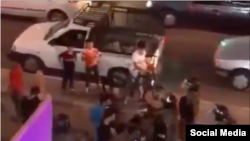 In this screen grab of a video shared on social media on July 15, 2021, Iranian protesters appear to confront police in southwestern Iran's Khuzestan province as part of a wave of demonstrations in the province against water shortages.