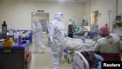 FILE - Medical staff dressed in protective suits treat coronavirus disease patients at the COVID-19 ICU of Machakos Level 5 Hospital, in Machakos, Kenya, Oct. 28, 2020.