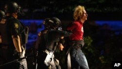 Portland police make arrests on the scene of the nightly protests at a Portland police precinct, August 30, 2020 in Portland, Oregon.
