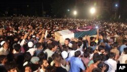 Pakistani attend funeral of Pakistani soldier Taimoor Aslam who reportedly was killed during a firing at the Line of Control between Pakistan and Indian Kashmiris, Aug. 16, 2019, in Lahore, Pakistan.