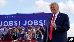 President Donald Trump arrives to speak at a campaign rally at Wittman Airport in Oshkosh, Wis., Aug. 17, 2020.