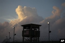 FILE - A guard tower in front of the detention facility on Guantanamo Bay US Naval Base in Cuba in 2019.