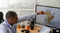 Kenneth Mwangi, a satellite information analyst at the Intergovernmental Authority on Development's Climate Prediction and Applications Center, shows a map predicting the movement of desert locust swarms, in Nairobi, Kenya, March 5, 2020.