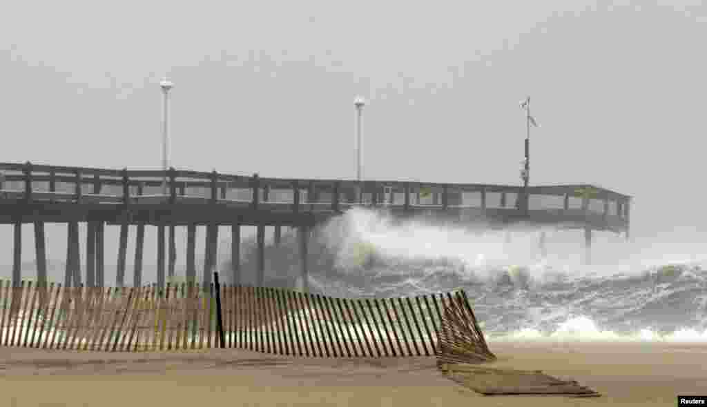 Waves crash into the pier in Ocean City, Maryland October 28, 2012.