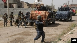 Pasukan keamanan Irak berhasil mengusir militan ISIS dari kota Tikrit di utara Baghdad (30/3).