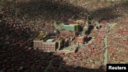 FILE - A view of the settlements of Larung Gar Buddhist Academy in Sertar County of Ganze Tibetan Autonomous Prefecture, Sichuan province, China, July 23, 2015.