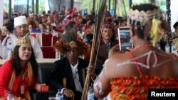 Participants take photos on the sidelines of an indigenous peoples gathering on Sumatra island, Indonesia, March 17, 2017.