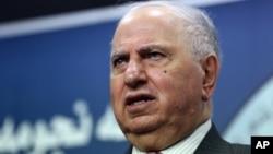 FILE - Ahmad Chalabi speaks to the media in Baghdad.