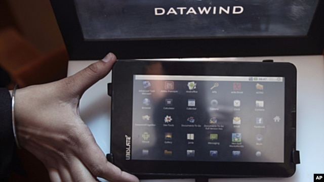 A DataWind representative displays the supercheap 'Aakash' Tablet computers during its launch in  New Delhi, India. The $35 basic touchscreen tablet aimed at students can be used for functions like word processing, web browsing and video conferencing. 'Aa