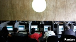 Computer users are seen at an internet cafe in Sao Paulo, Brazil, in this March 3, 2011 file photo. (REUTERS/Nacho Doce)