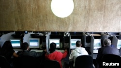 Computer users are pictured at an internet cafe in Sao Paulo, Brazil, March 3, 2011.