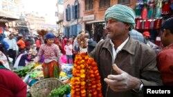 FILE - Vendors in Kathmandu.