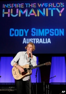 Australian singer/songwriter Cody Simpson performs at the #ShareHumanity event, celebrating World Humanitarian Day at the United Nations in New York, August 18, 2015.