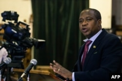 Zimbabwe's Finance Minister Mthuli Ncube delivers a speech to present his mid-term budget statement on Aug. 1, 2019, in Harare.