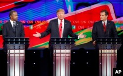Donald Trump, center, speaks as Ben Carson, left, and Ted Cruz look on during the CNN Republican presidential debate at the Venetian Hotel & Casino on Dec. 15, 2015, in Las Vegas.