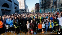 A crowd gathers at the finish line of the Boston Marathon in Boston for a Sports Illustrated photo shoot before the one-year anniversary of the Boston Marathon bombings, April 12, 2014.