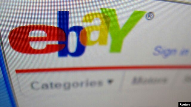 FILE - A photograph of a computer screen showing the website eBay in Encinitas, California.