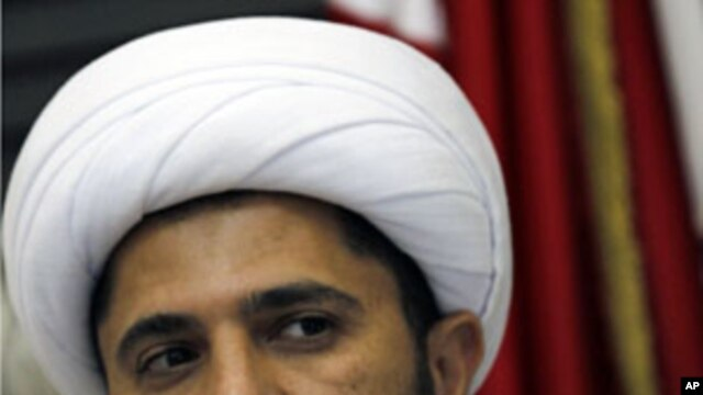 Bahrain's main Shi'ite Wefaq opposition group leader Sheikh Ali Salman speaks to journalists during a news conference in Manama, March 30, 2011