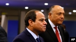 FILE - Egypt's President Abdel Fattah el-Sissi arrives for the 70th session of the United Nations General Assembly at U.N. headquarters. Egypt's president has vowed that those responsible for stripping an elderly Christian woman and parading her naked on the streets will be brought to justice.