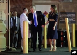 President Donald Trump and first lady Melania Trump talk with Dr. Ira Y. Rabin, left, after visiting MedStar Washington Hospital Center in Washington, June 14, 2017, where House Majority Leader Steve Scalise of La. was taken after being shot in Alexandria