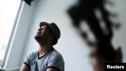 Venezuelan mVenezuelan migrant Alexander Beja sings after an interview with Reuters in Soacha, Colombia, Aug. 23, 2019.igrant Alexander Beja sings after an interview with Reuters in Soacha, Colombia, Aug. 23, 2019.