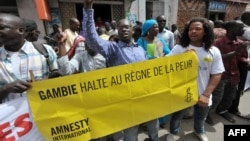 Protesters gather outside the Gambian embassy in Senegal to demand President Yahya Jammeh halt the mass execution of prisoners, August 30, 2012.