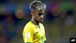 FILE - Brazil's Neymar looks down during the group A World Cup soccer match between Brazil and Mexico at the Arena Castelao in Fortaleza, Brazil, June 17, 2014.