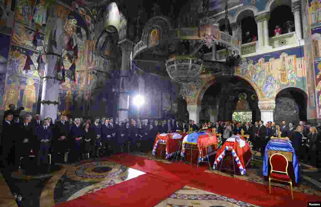 The coffins of Serbian King Petar II Karadjordjevic and his wife Queen Aleksandra, his mother Queen Maria and brother Prince Andrej inside the St. George's Church on Oplenac Hill during their funeral in Topola, some 71km (44 miles) south of Belgrade, Serbia. Hundreds of mourners gathered for the reburial of Serbian royals, decades after their deaths in exile.