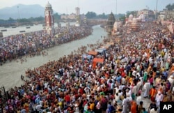 Hindu devotees gather on the banks of the River Ganges to take holy dips on the auspicious occasion of Somvati Amavasya in Haridwar, India, Monday, May 18, 2015.
