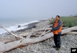 Robert Elofson stands on an eroded Lower Elwha Klallam reservation beach that he hopes will be repopulated with clams after it is nourished with river sediments now trapped behind two Elwha River dams.