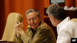 FILE - Cuba's President Raul Castro, left, and Vice President Miguel Diaz-Canel.