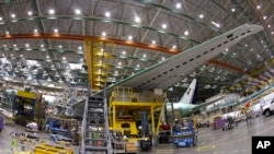 FILE - A Boeing 777 plane on the assembly line in Everett, Washington.