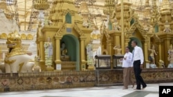 FILE - President Barack Obama, right, tours the Shwedagon Pagoda in Yangon, Myanmar, November 19, 2012.