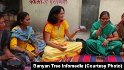 Indian physician Aparna Hegde meets with villagers in Solapur, Maharashtra state, to explain how mobile technology can improve health care.