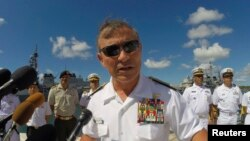 FILE - U.S. Navy Admiral Harry Harris Jr. addresses the media during a news conference kicking off the RIMPAC exercise at Joint Base Pearl Harbor Hickam in Honolulu, Hawaii, June 30, 2014.